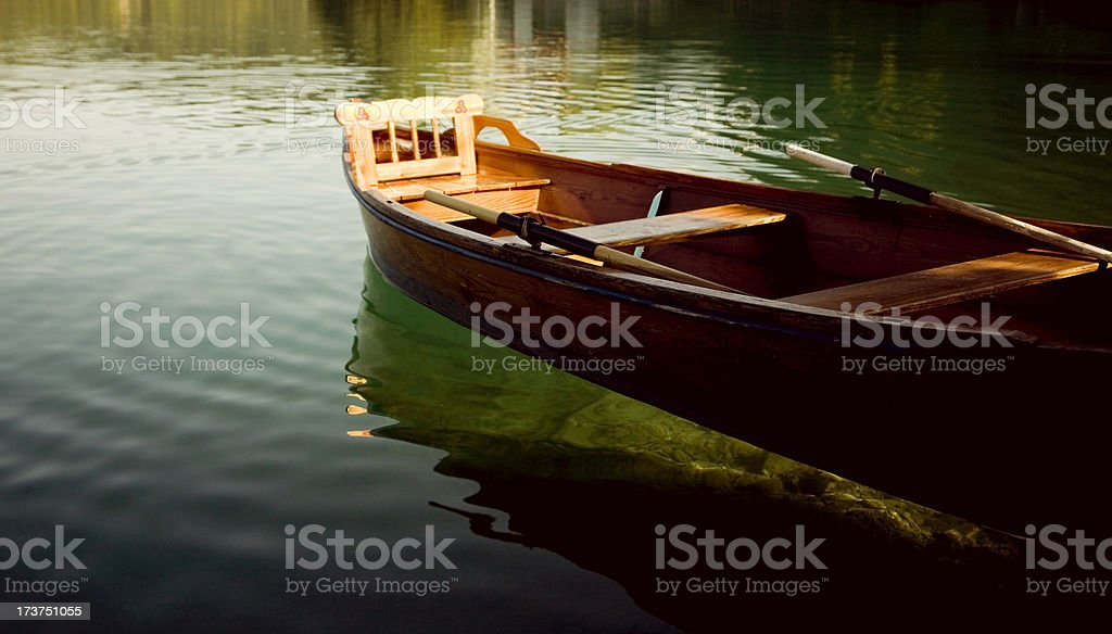 rowing boat in a clear lake royalty-free stock photo