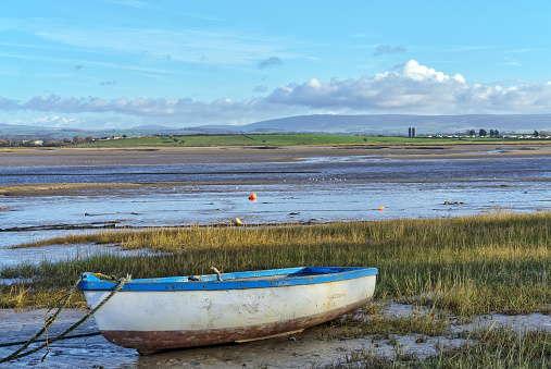 A rowing boat on the shore at Sunderland Point, Lancashire, at low tide