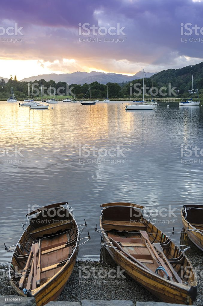 Rowing Boats at Sunset stock photo