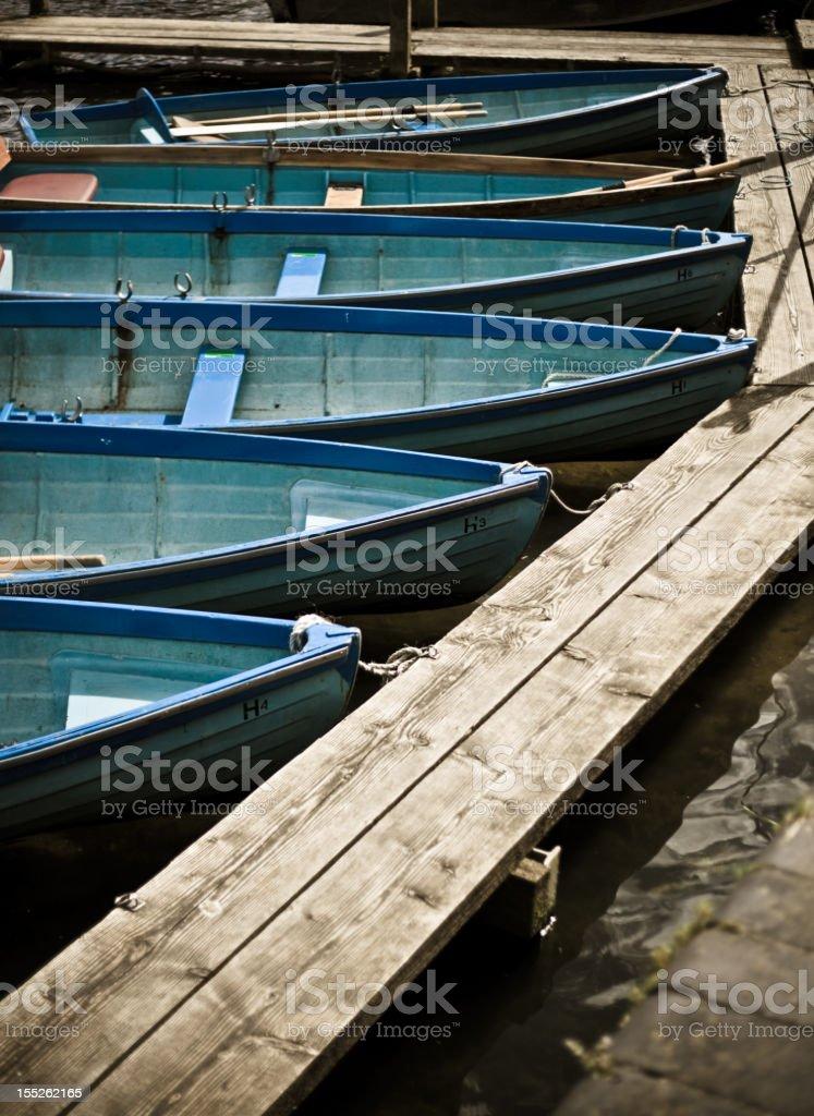 Rowing boats docked stock photo