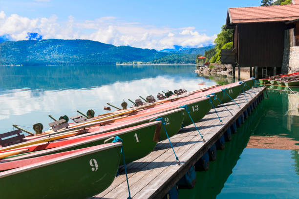 Rowing boats on a mountain lake stock photo