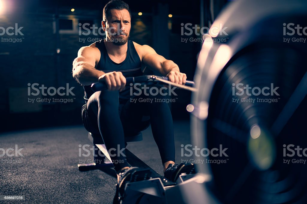 Rowing machine exercising stock photo