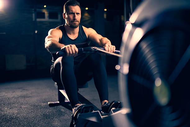 Rowing machine exercising stock photo