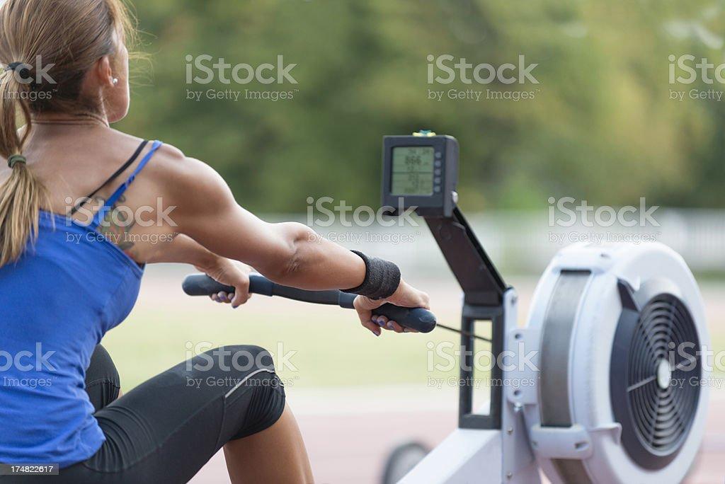 Rowing machine workout royalty-free stock photo