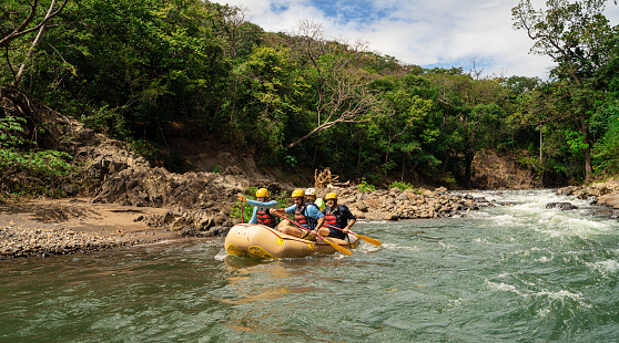 Rowing on inflatable raft Costa Rica
