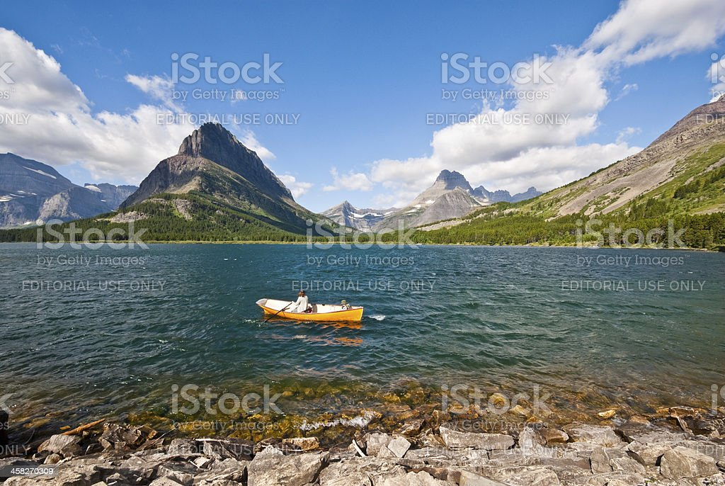 Rowing on Swiftcurrent Lake royalty-free stock photo