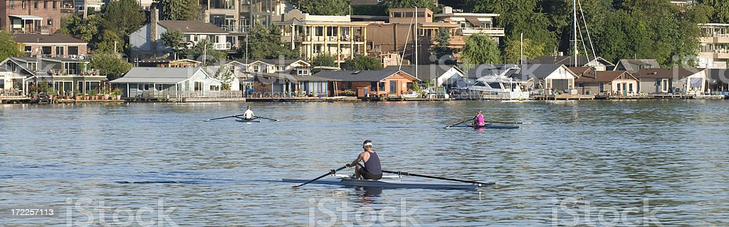 Rowing Past Seattle Houseboats stock photo