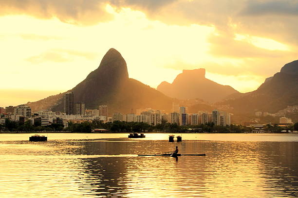Rowing Rowing in the sunset lagoa rio de janeiro stock pictures, royalty-free photos & images