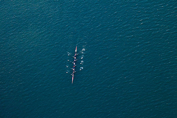 rowing scull boat on Colorado River near Austin Texas stock photo
