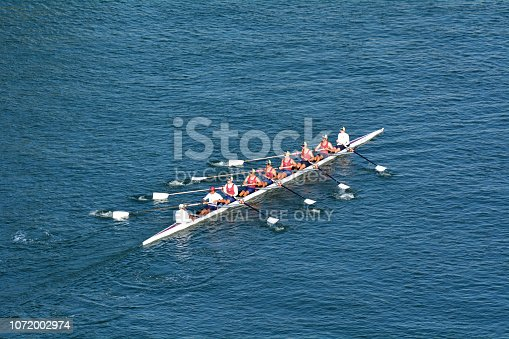 GOLD COAST - NOV 22 2018:Aerial view of Australian rowers row a coxed eight (8+), a sweep rowing boat, In Surfers Paradise Gold Coast, Queensland Australia.