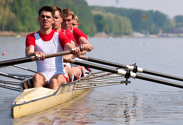 Rowing team during the start stock photo
