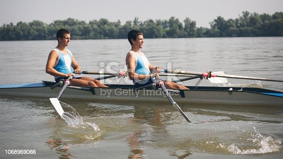 Outdoor shoots of rowing team exercising on the Danube river. Shallow DOF. Developed from RAW; retouched with special care and attention; Small amount of grain added for best final impression. Adobe RGB color profile.