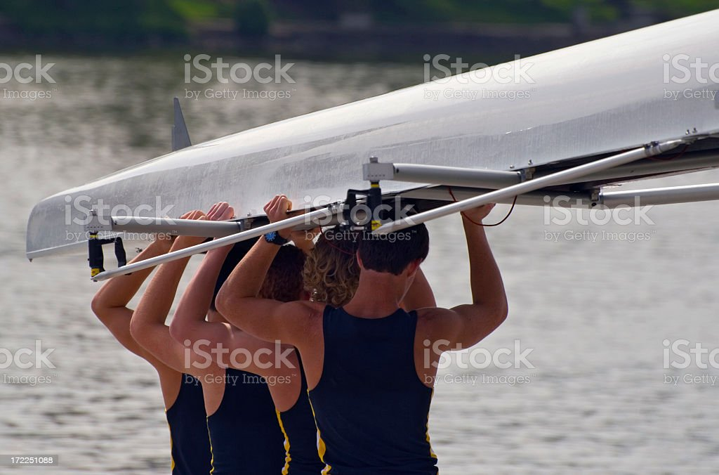 Rowing team putting their kayak into the water stock photo