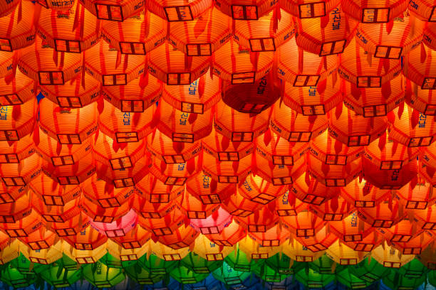 Rows and rows of colorful illuminated buddhist lotus lanterns stock photo