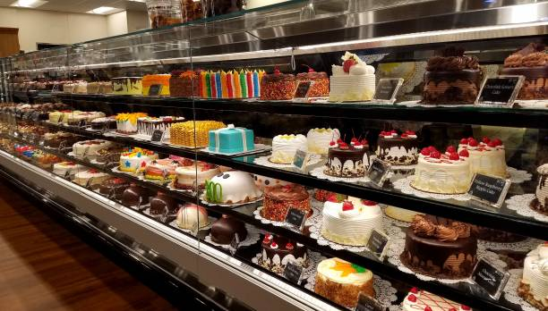 Rows and Rows of Varieties of Decorated Cakes for Sale stock photo