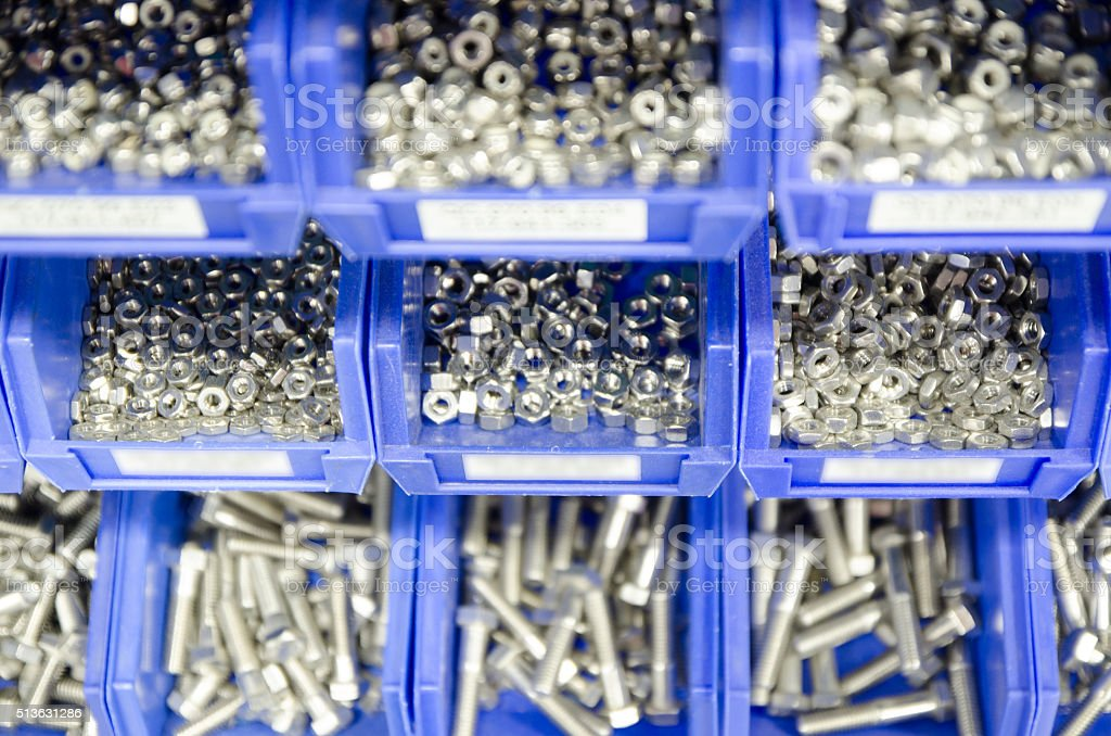 Rows Blue Plastic Storage Bins Containing Screws, Bolts And Nuts.  Royalty Free Stock