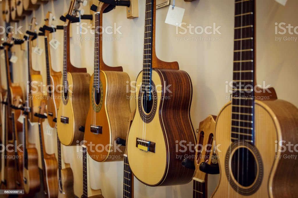 Rows of acoustic guitars on the wall royalty-free stock photo