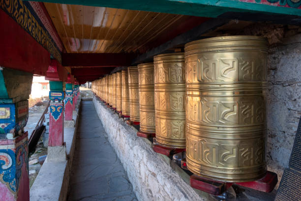 Rows of ancient traditional golden wheels of tibetan temple stock photo