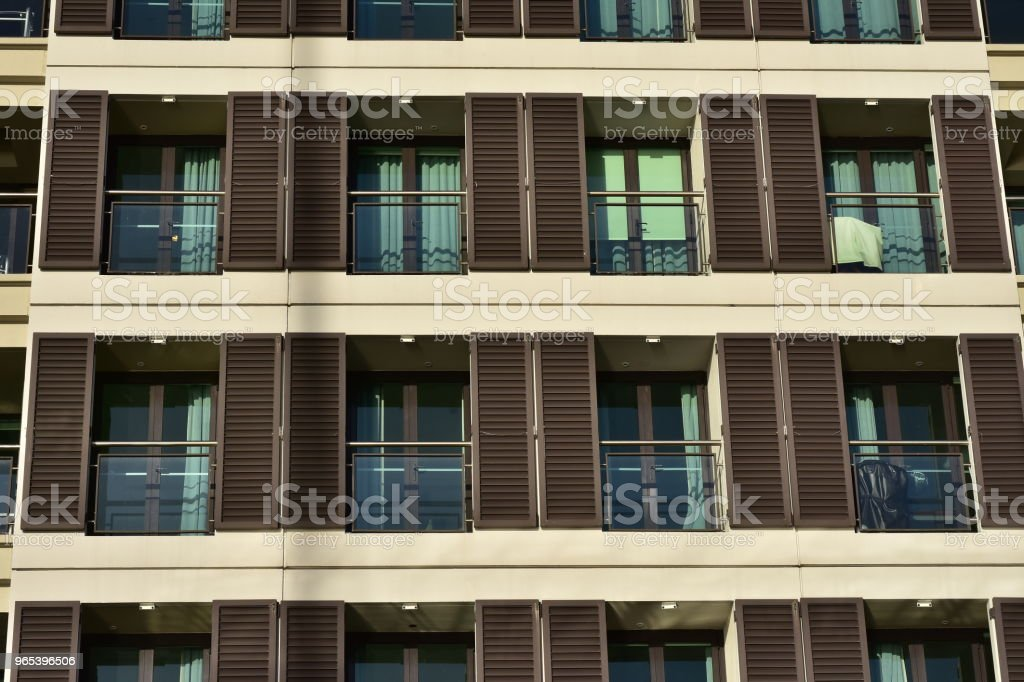 Rows of balconies with blinds zbiór zdjęć royalty-free