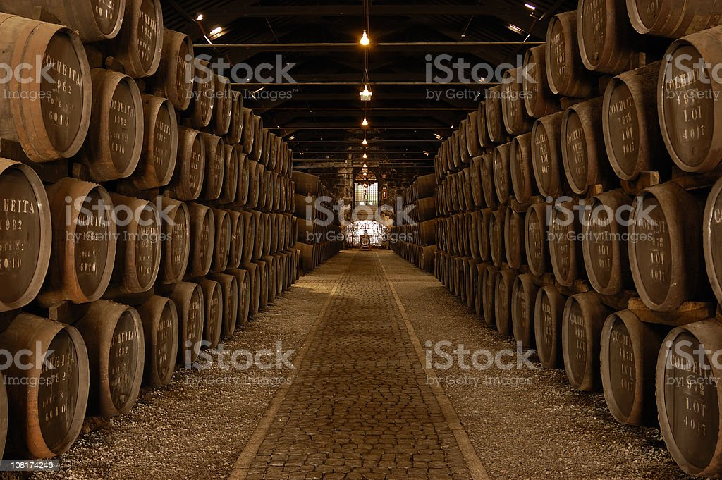 Rows of Barrels in a Large Wine Cellar royalty-free stock photo