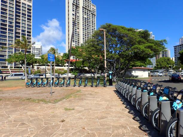 Rows of Biki Bikeshare in Ala Moana Beach Park stock photo