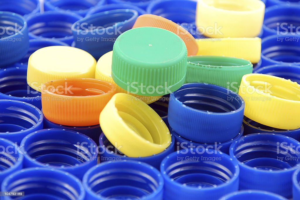 Rows of blue and colorful plastic lids - caps stock photo
