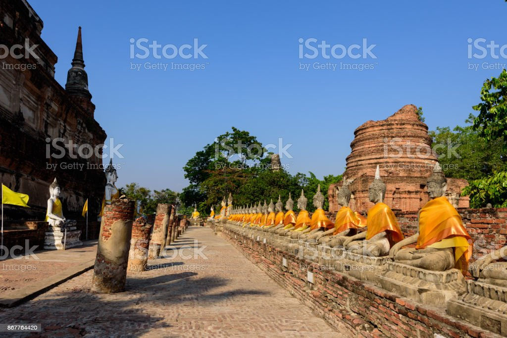 Rows of Buddha Images Wat Yai Chai Mongkon in Ayutthaya stock photo