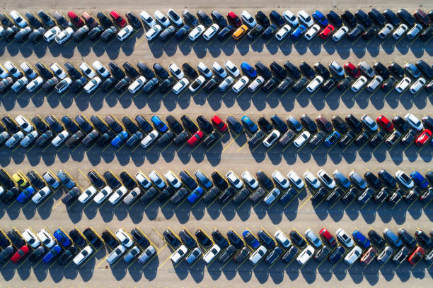 Rows of cars in a large parking lot, aerial view Aerial photograph of rows of cars parked in a large parking lot. full stock pictures, royalty-free photos & images