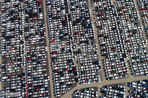 652712094 istock photo Rows of Cars Viewed from Above 1152052110