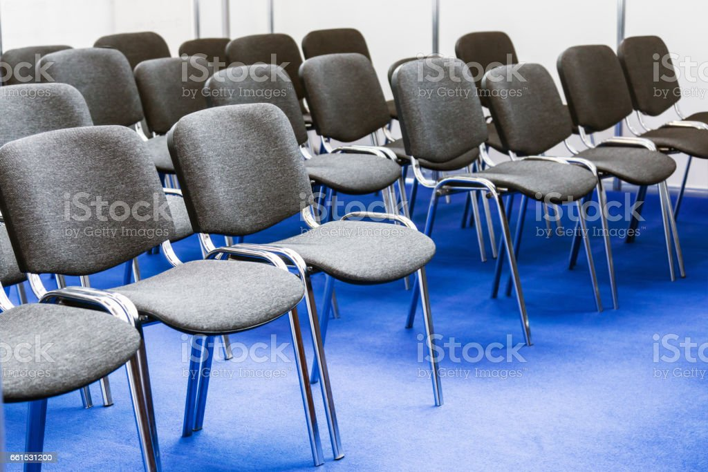 Rows of chairs at a conference stock photo