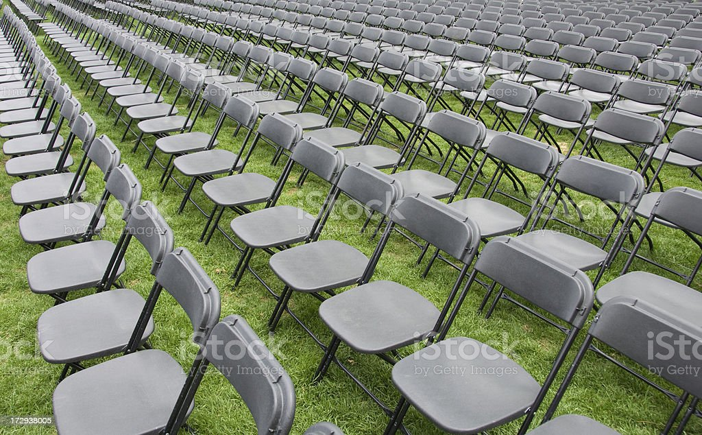 Rows of chairs at the ready stock photo