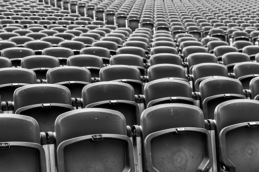Rows of Chairs in an open air theatre.