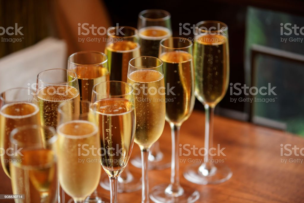 Rows of champagne and wine glasses on alcohol party and wedding reception stock photo
