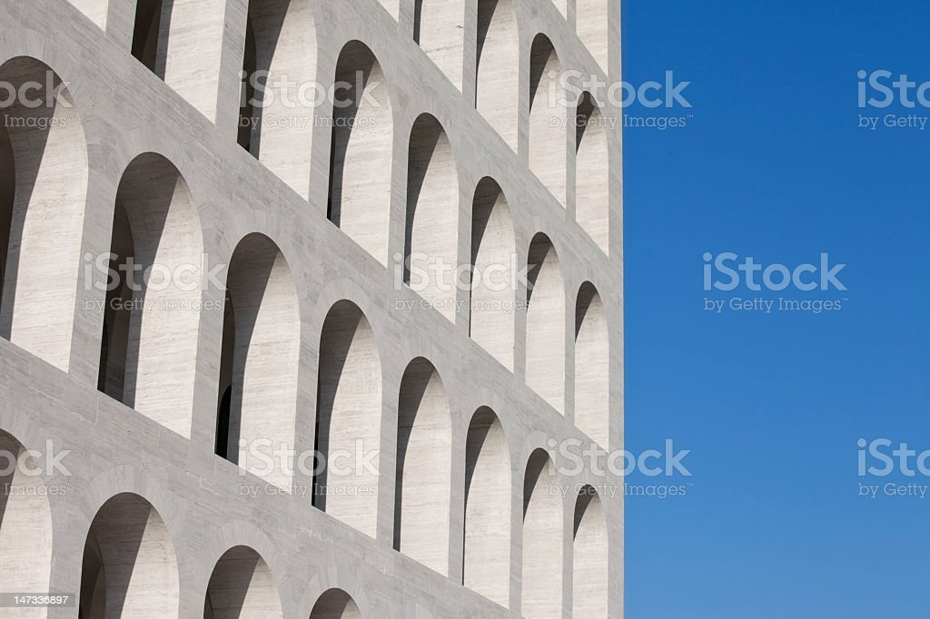 Rows of classic arches on white building and blue sky stock photo