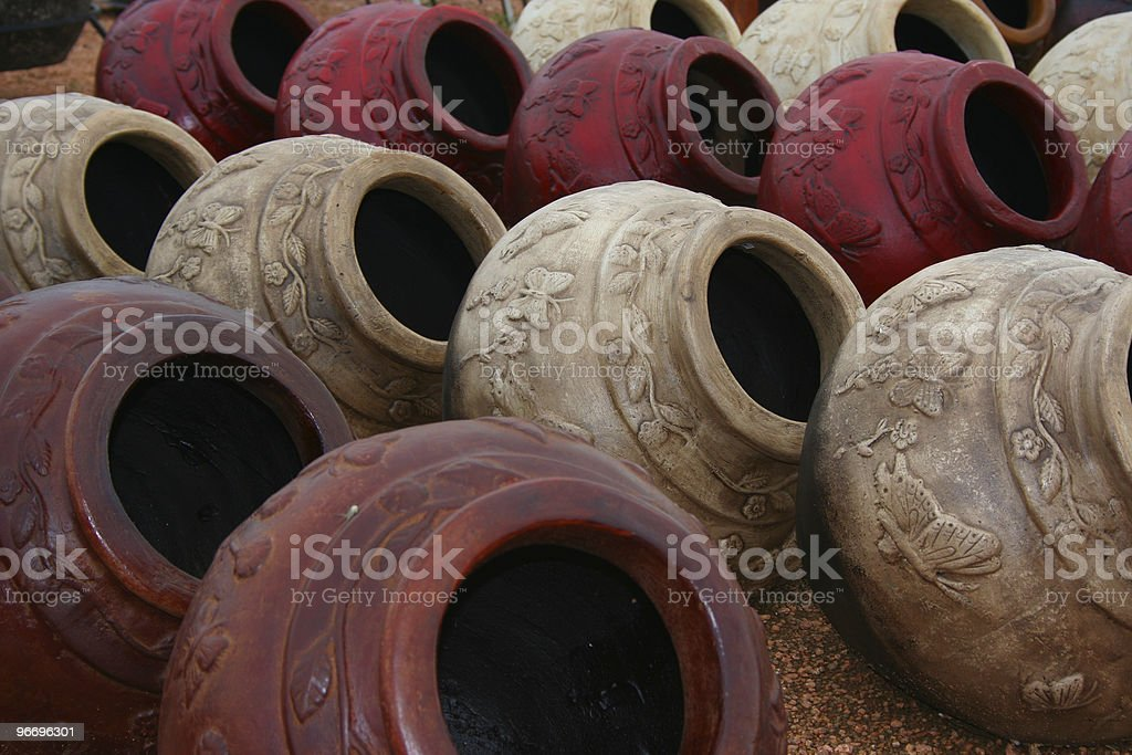 Rows of clay pottery displayed and for sale at nursery royalty-free stock photo
