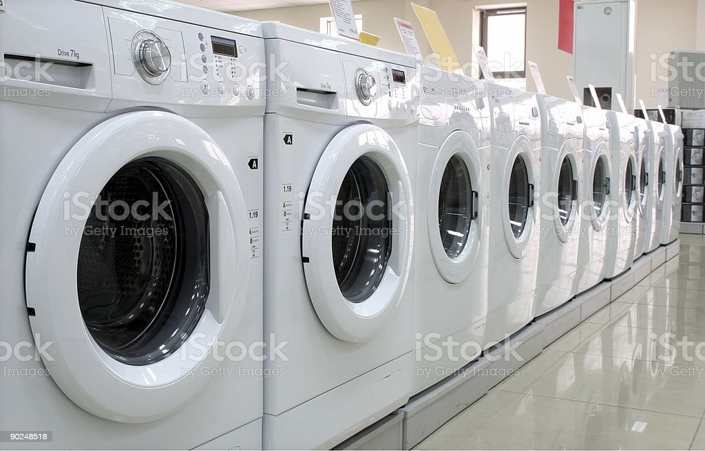 Rows of clothes washers in a store stock photo