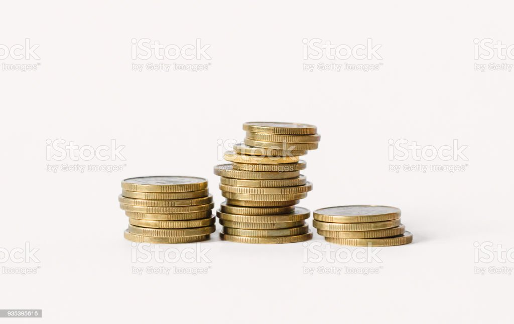 Rows of coins isolated on white background. Finance and banking concept. stock photo