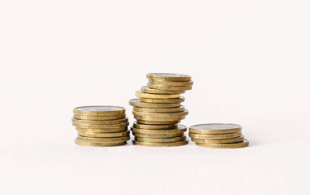 rows of coins isolated on white background. finance and banking concept. - coin stock photos and pictures