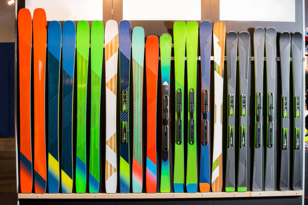 Rows of colourful skis on wall. stock photo