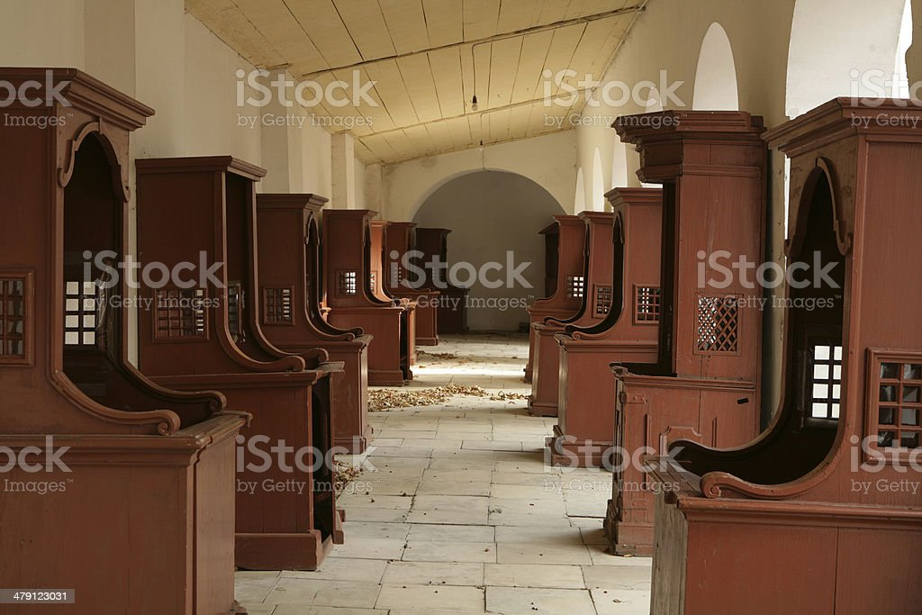 rows of confessionals in eastern european monastery royalty-free stock photo