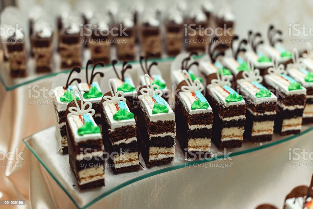 Rows of different dessert cakes on the candy bar stock photo