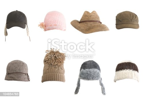 A collection of various hats isolated on white.