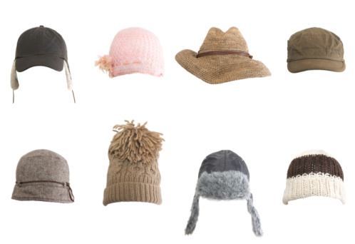 Rows of different kinds of hats against white background