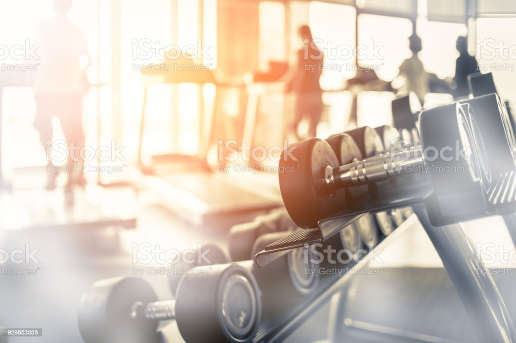 Rows of dumbbells in the gym with hign contrast and monochrome color tone stock photo