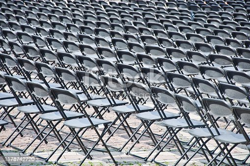istock Rows of empty black seats 1178742720