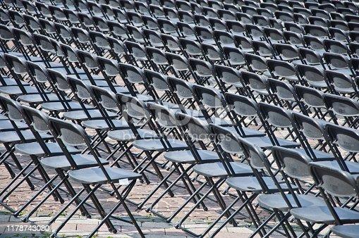 istock Rows of empty black seats 1178743080