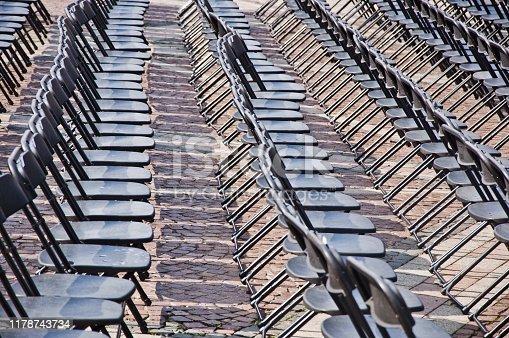 istock Rows of empty black seats 1178743734