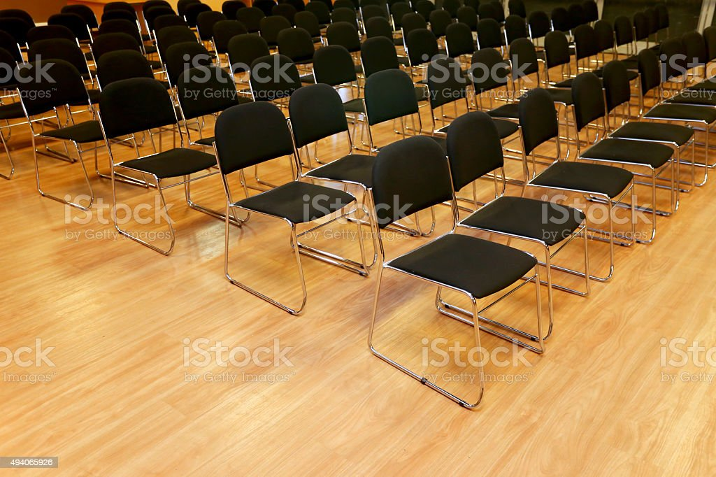 Rows of empty chairs in a seminar hall stock photo