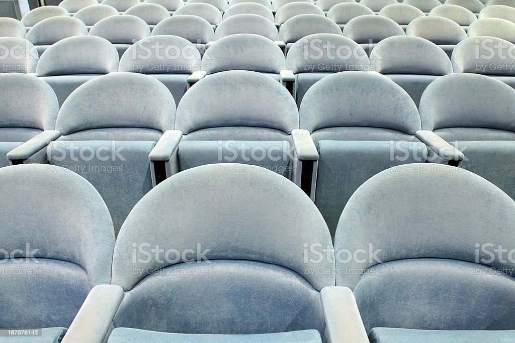 Rows of empty cinema seats royalty-free stock photo