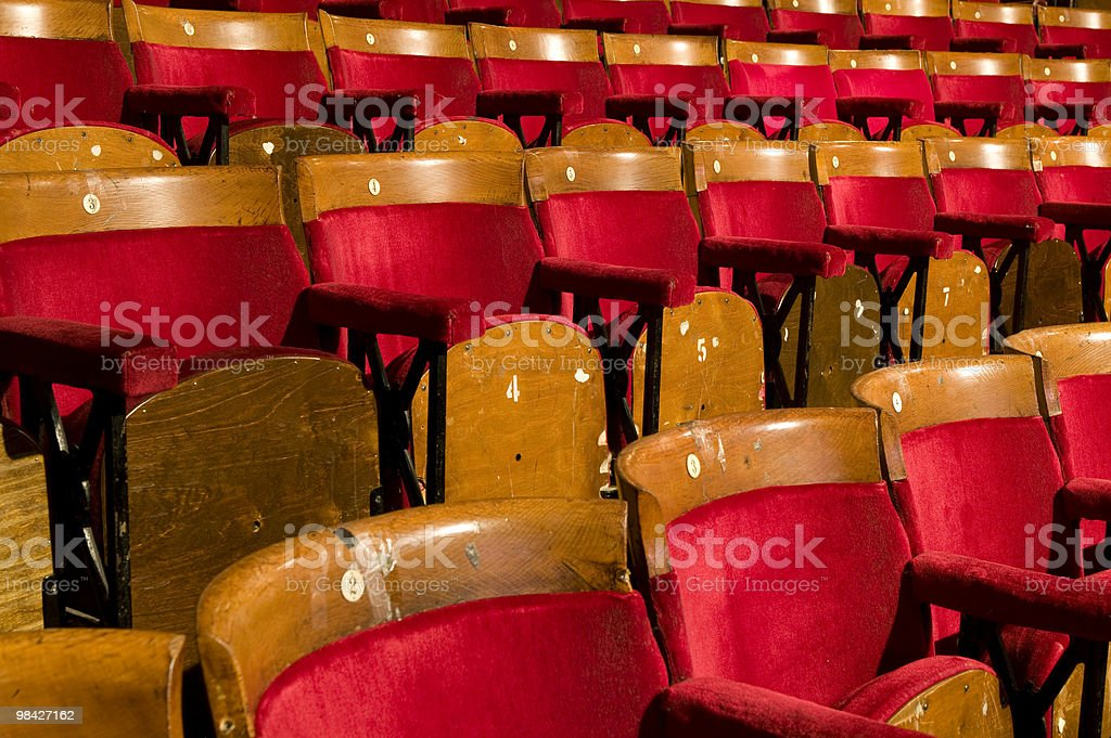 Rows of empty old red theatre seats royalty-free stock photo